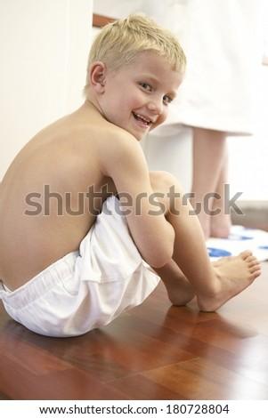 Young boy in bathroom