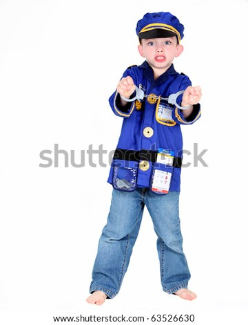 Young boy in police costume with handcuffs on white background