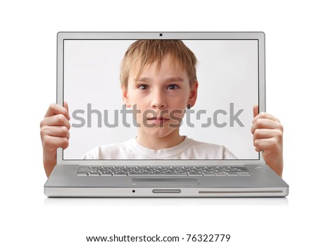 Young boy inside laptop, hands holding screen, clipping path