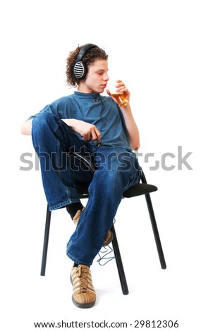 Young boy is listening to the music and drinking alcohol