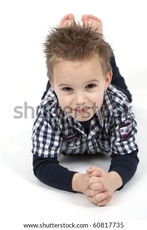 Young boy is posing for the camera