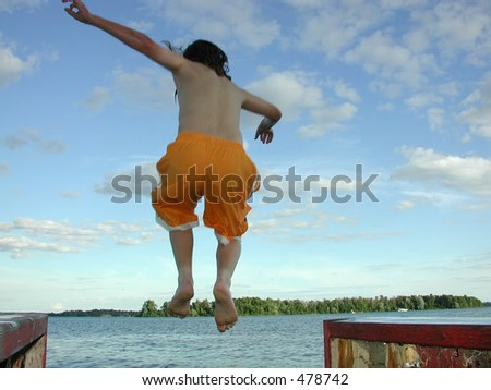 young boy jumping off a dock in the St. Lawrence River