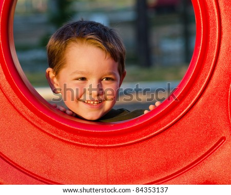 Young boy, kid or child playing outdoors on playground.