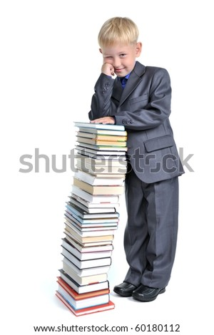 Young Boy leaning over  a Pile of Books
