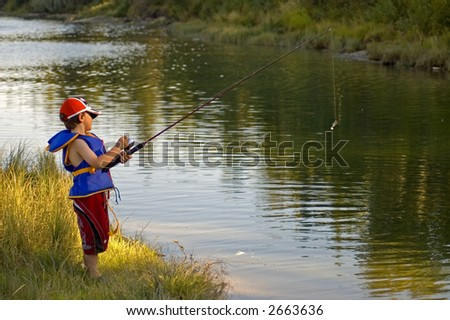 Young Boy Learning to Fish