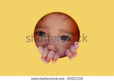 Young boy looking through playground hall - stock photo