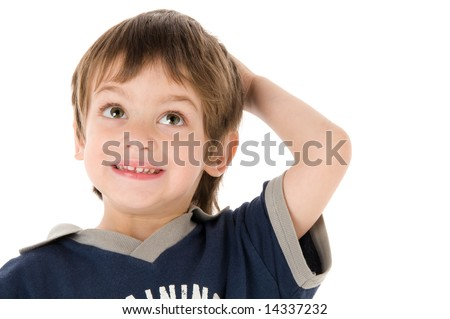 Young boy looking up with  hand between the hair
