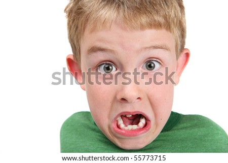 Young boy making a surprised face