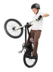 Young Boy making Tricks on Bike