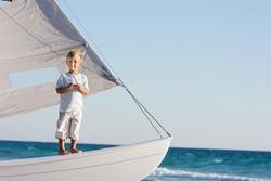 young boy on board sea yacht
