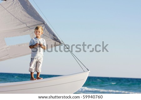 young boy on board sea yacht
