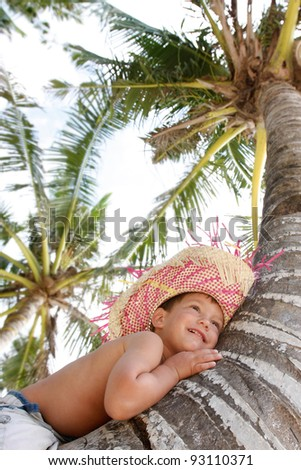 young boy on palm tree