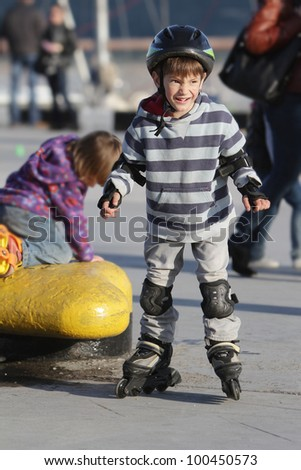young boy on roller skates