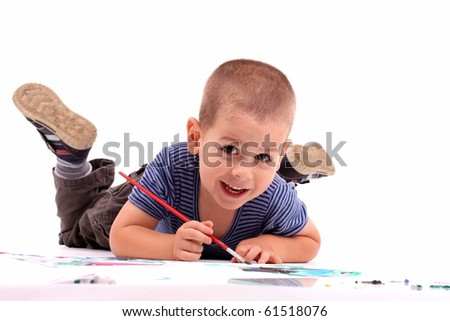 young boy painting over white - stock photo