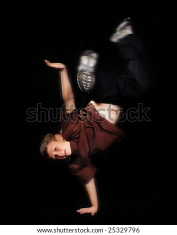 Young boy performing aerobic dance routine