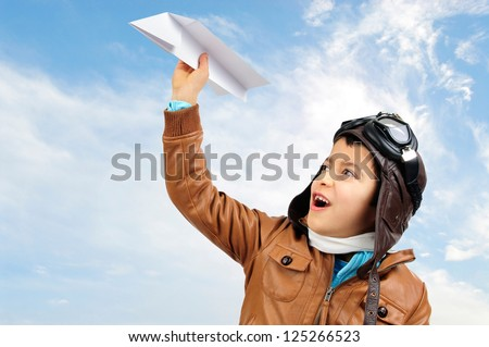 Young boy pilot with a paper plane