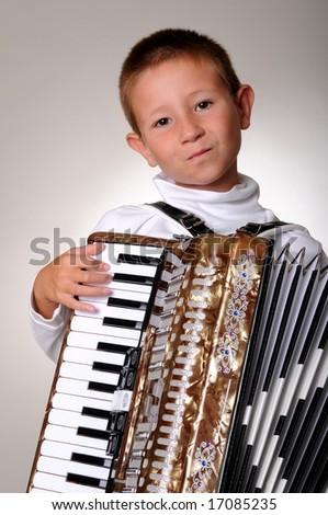 Young boy playing a 48 base accordion