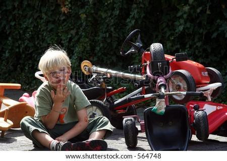 Young boy playing crash victim