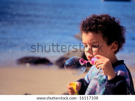 Young boy playing on the beach.