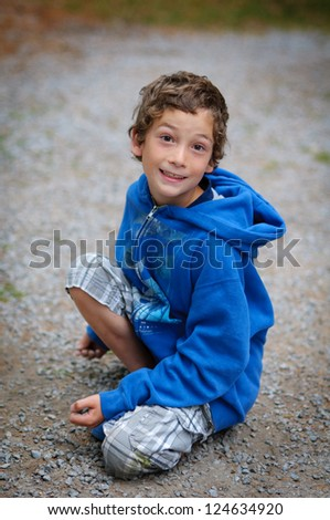 young boy playing outdoors in summer