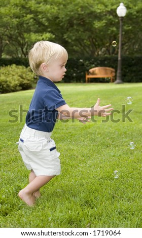 Young boy playing with bubbles