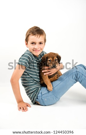Young Boy Playing with His Puppy