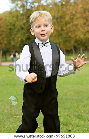young boy playing with soap bubbles