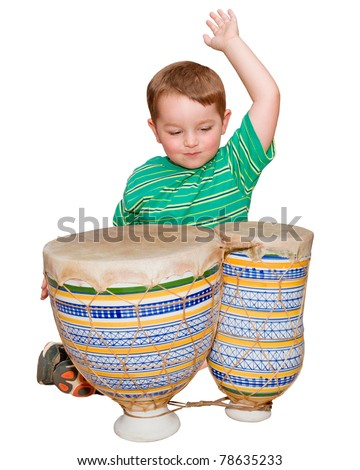 Young boy plays African bongo tom-tom drums, isolated on white background