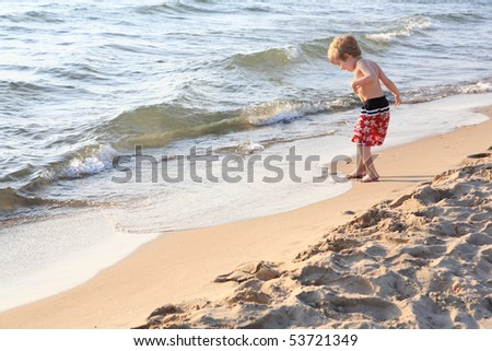 Young boy plays on the shore