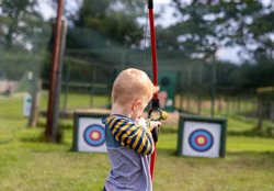Young boy practising his archery