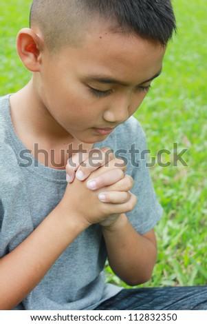 Young boy praying.
