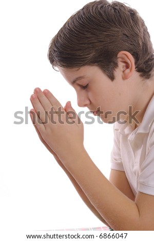 young boy praying on white vertical