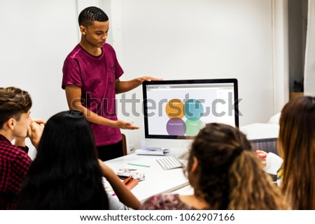 Young boy presenting a project to the team #1062907166