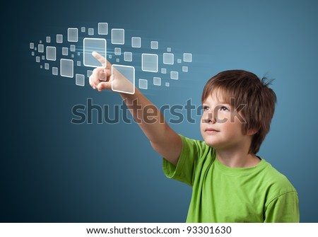 Young boy pressing high tech type of modern buttons on a virtual background - stock photo