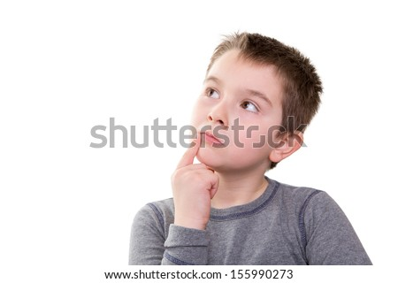 Young boy pushing the limits of his thought process, isolated on white
