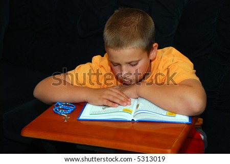 Young Boy Reading a child's Bible