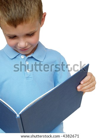young boy reading a picture book