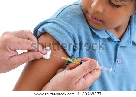 Young boy receiving vaccination immunisation by professional health worker,