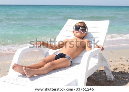 young boy relaxing on beach