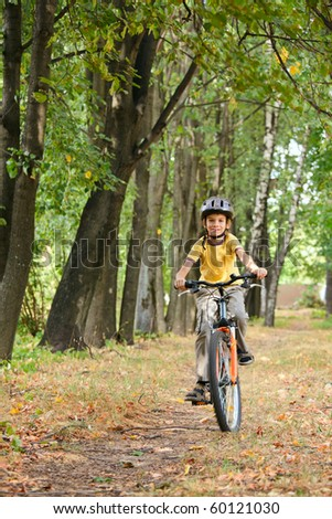 Young boy riding bicycle in a park