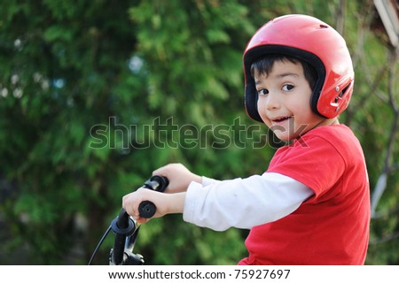 Young boy riding bicycle, shallow dof