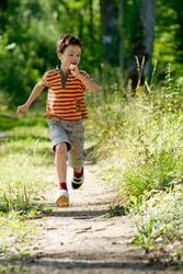 Young boy running in nature