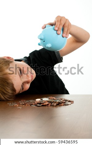 Young Boy Shaking Money out of Blue Piggy Bank
