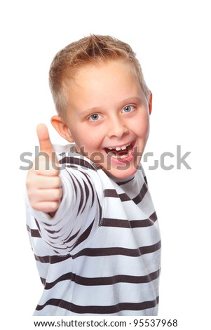 young boy shows thumb up