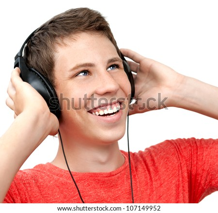 Young boy smiling and listening to music on headphones