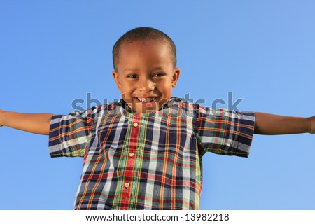 Young Boy Smiling and Spreading His Arms