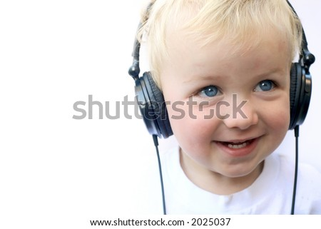 Young boy smiling and wearing headphones