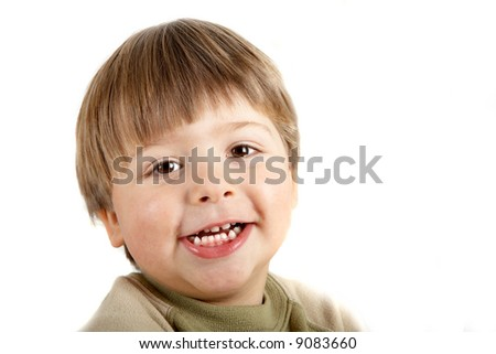 Young boy smillng and looking at the camera