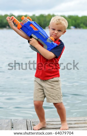 Young Boy Sneers with Water Gun