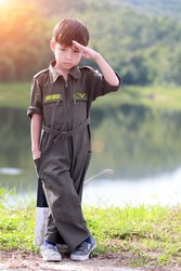 Young boy soldier in air force suit